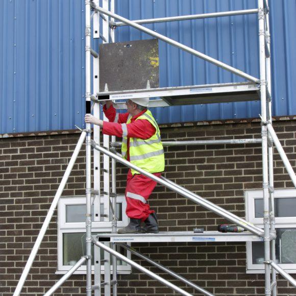 A man on scaffolding.