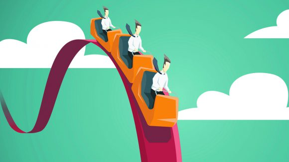 Businessman riding on a roller coaster