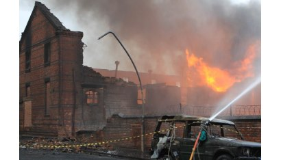 A burning building being put out.