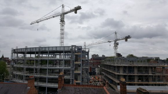 A building site with cranes.