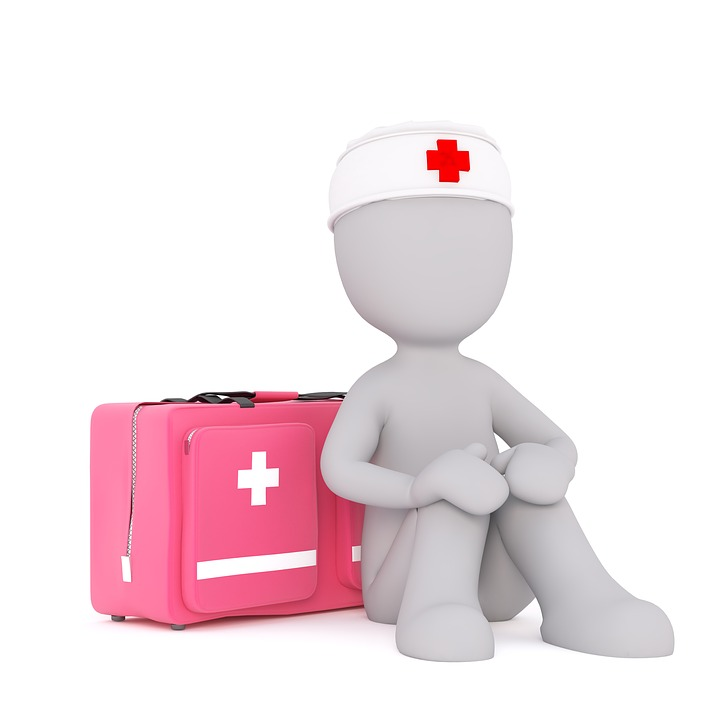 An illustration of a pink first aid kit next to a sitting person wearing a white headband with a red cross on.