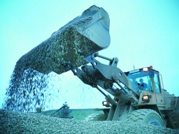 A digger shoveling.
