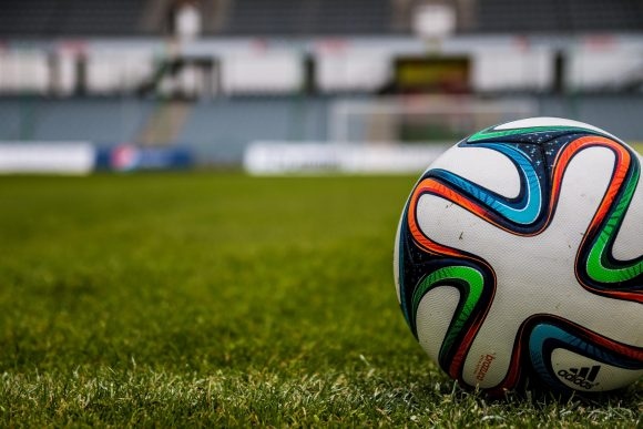 A football on a pitch.