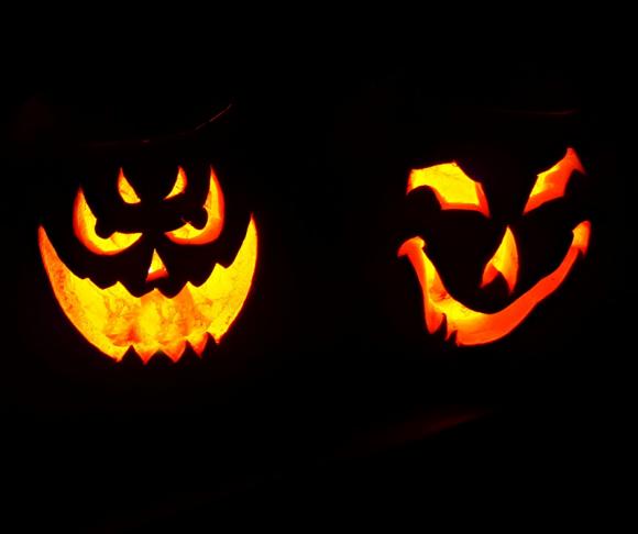 Lit-up carved Halloween pumpkins.