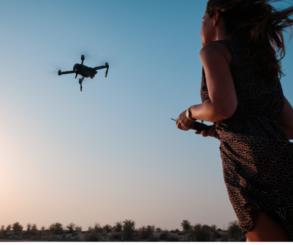 A girl flying a drone.