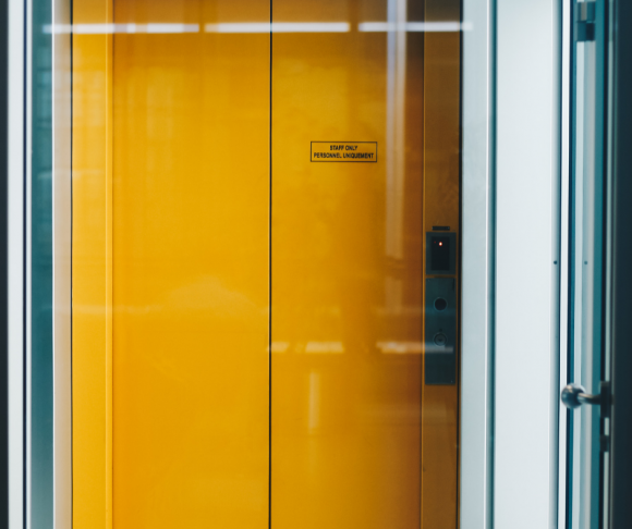 A yellow elevator door.