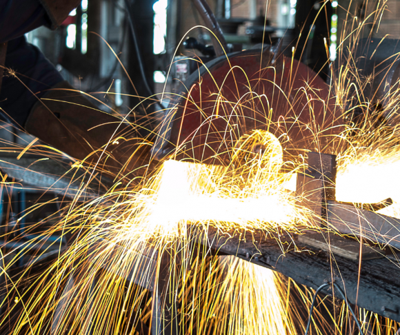 Sparks flying from a saw.