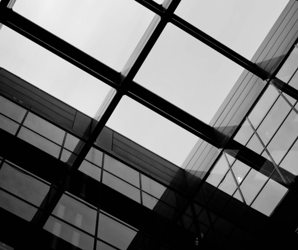 Windows on a building in black and white.