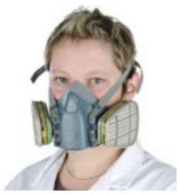 A person wearing a reusable half mask breathing apparatus with a gas / vapour filter.