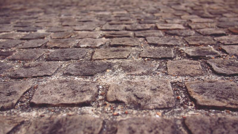 A cobbled uneven street.
