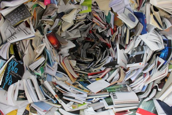 A swirling pile of books