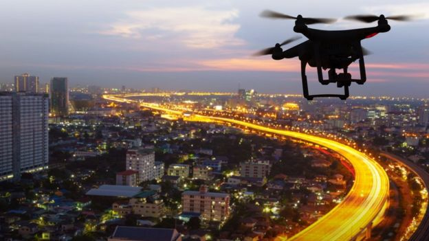 A drone flying above a city.