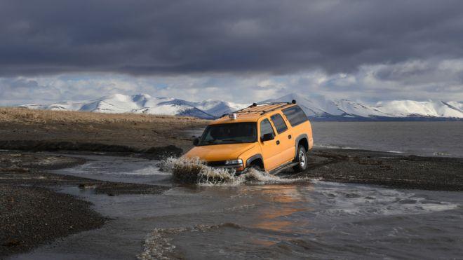 A 4x4 driving through peatlands.