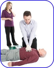 A man giving someone CPR while a female bystander calls for an ambulance.