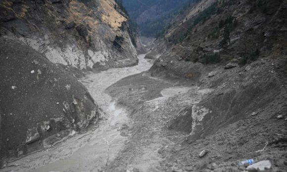 The Rishiganga river in Chamoli district on 9 February, with debris from the hydroelectric plant visible.