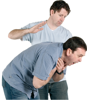 A man performing back blows on another man who is choking.