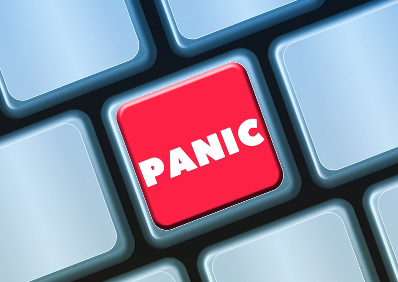 A red button on a keyboard reading 'PANIC' in white letters.