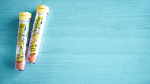 Epinepherine Auto-Injectors with Teal Background