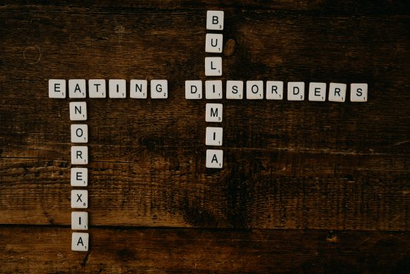 Scrabble tiles spelling out words related to Eating Disorders.