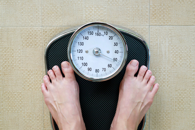 A person standing on weighing scales
